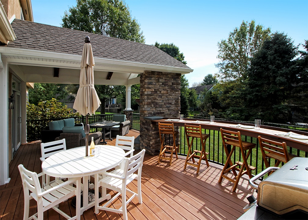 custom deck with grill space and bar seating