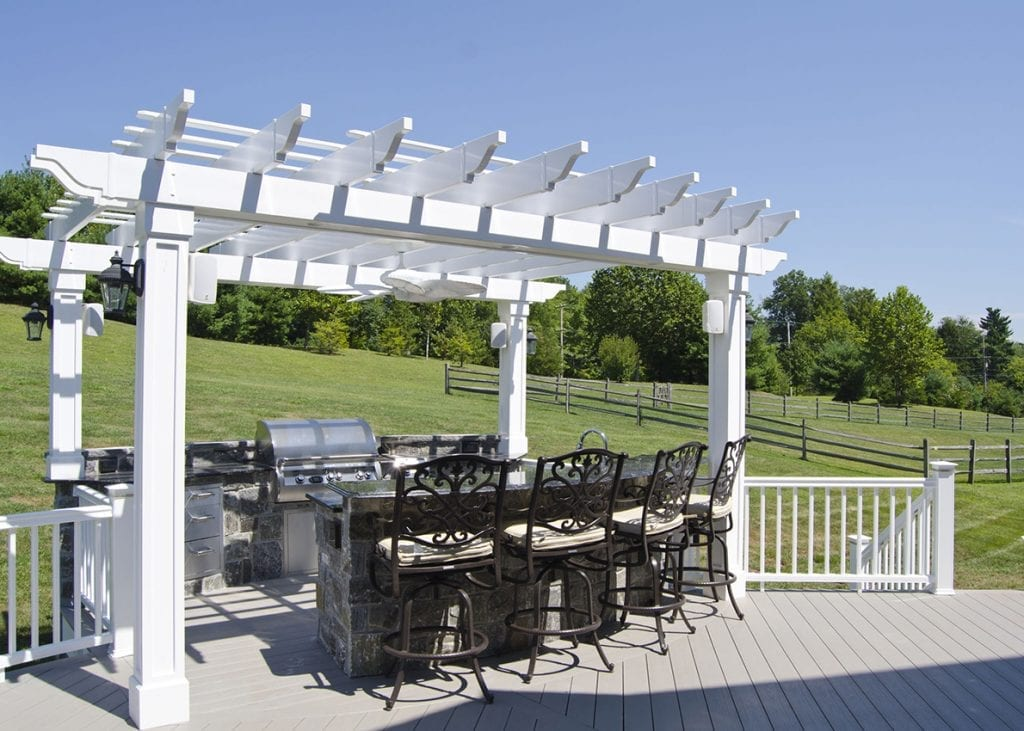 outdoor grilling station covered with pergola