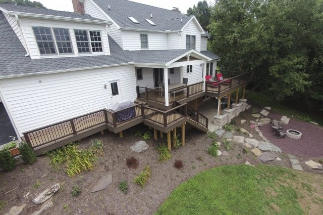 deck with walkway to the driveway along with a designated grilling station