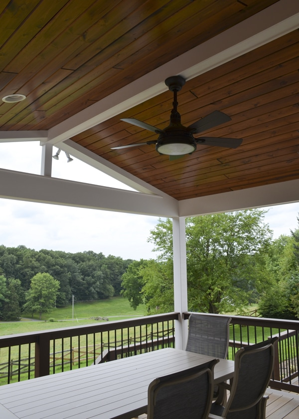 interior of porch dining area with ceiling fan