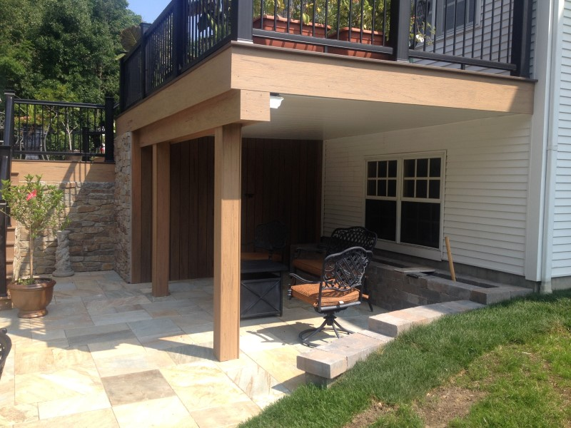 poolside storage area with timbertech black radiance railing on deck