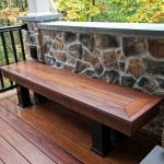deck bench with stone wall