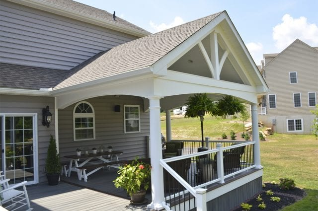 porch featuring a custom gable detail finished in white vinyl