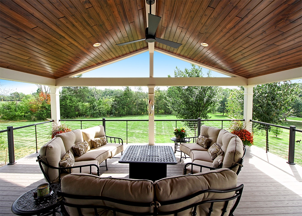 interior of a furnished porch with ceiling fan