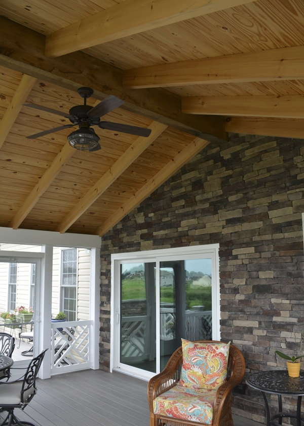 back wall of screened-in-porch completely clad in stone
