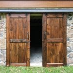 outdoor storage room doors surrounded by stone work