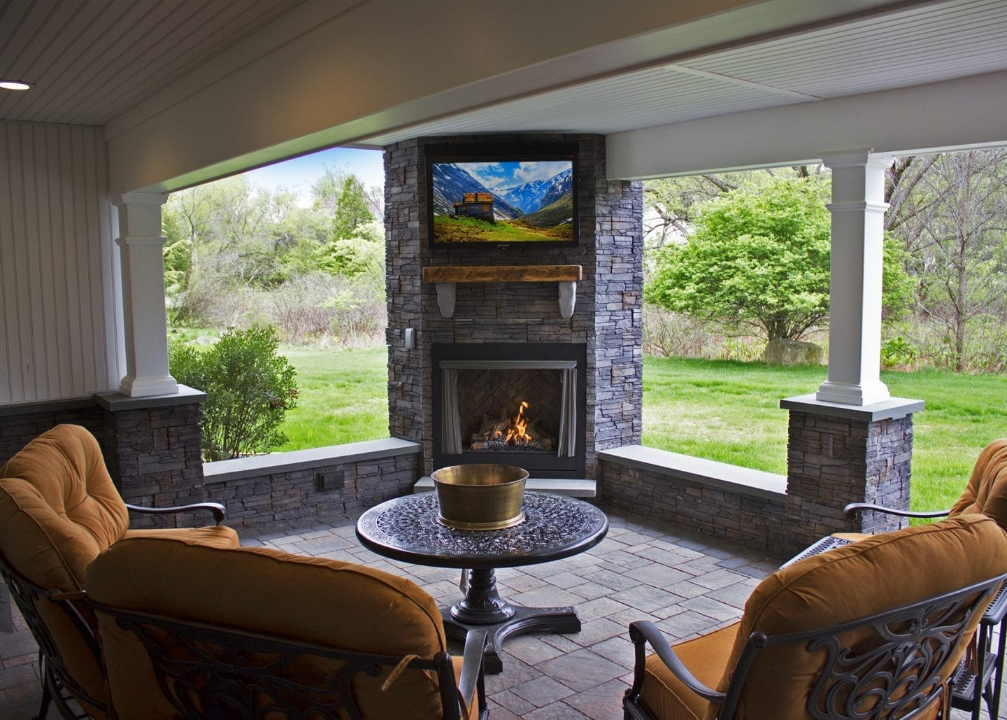 patio with tv fireplace combo
