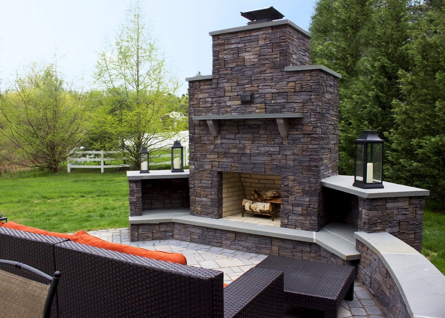 wood burning fireplace located in the corner of a patio