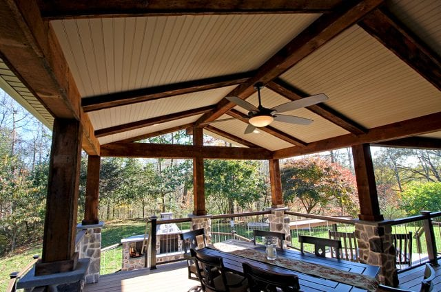 Neumoyer - trex spiced rum deck and barn wood porch with stone columns