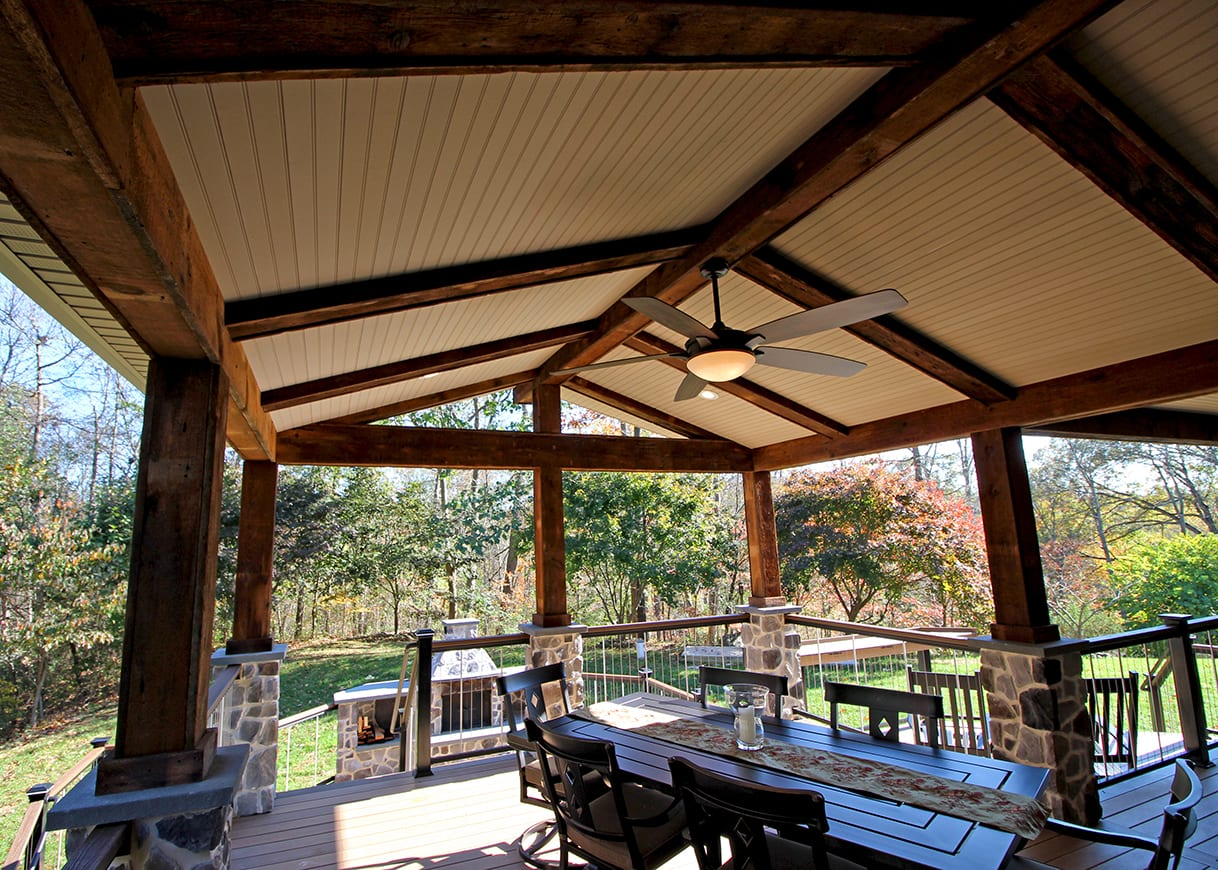 covered back porch with exposed beams