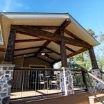 Neumoyer - trex spiced rum deck with barn wood porch with stone columns