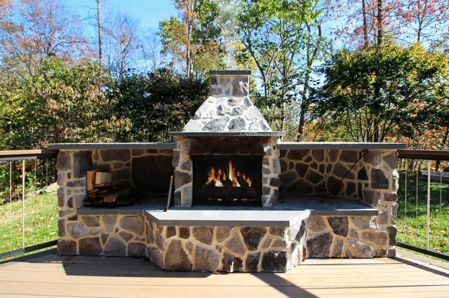Neumoyer - trex spiced rum deck with mocha border with stone fire feature