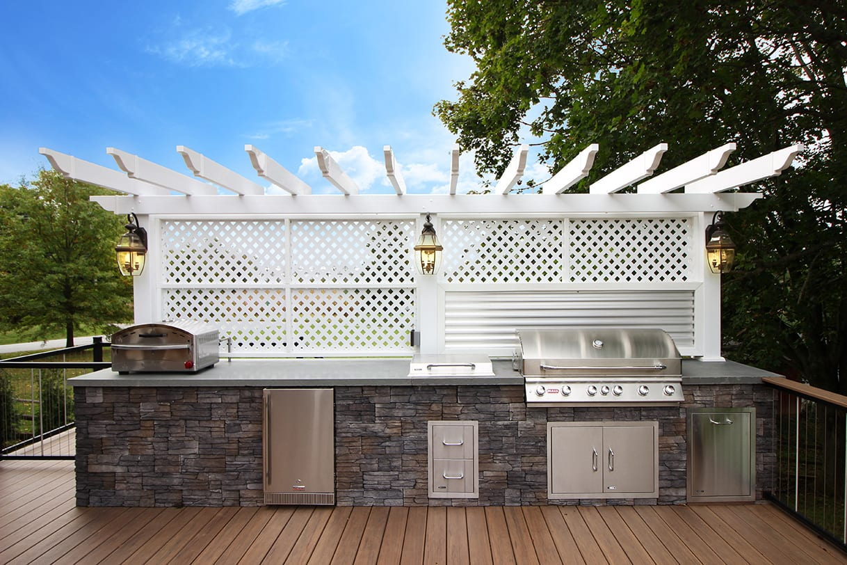 fully stocked outdoor kitchen shaded with vinyl pergola