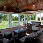 Gandhi - Timbertech deck and porch with kitchen
