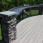 Belles - TimberTech Ashwood deck and porch with curved concrete bar top