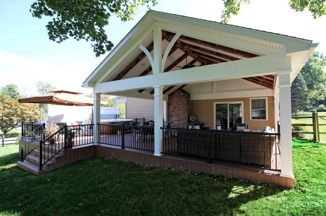 Tomlin - Timbertech Antigua gold deck With open porch and barnwood beams