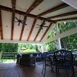 Tomlin - Timbertech Antigua gold deck and porch with barnwood beams, lights and fan
