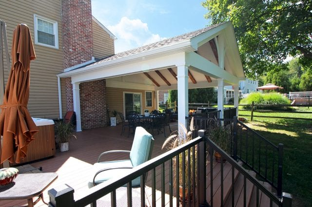Tomlin - Timbertech Antigua gold deck and porch with hot tub