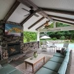 Manning - Timbertech deck and porch with barnwood and stonework fireplace