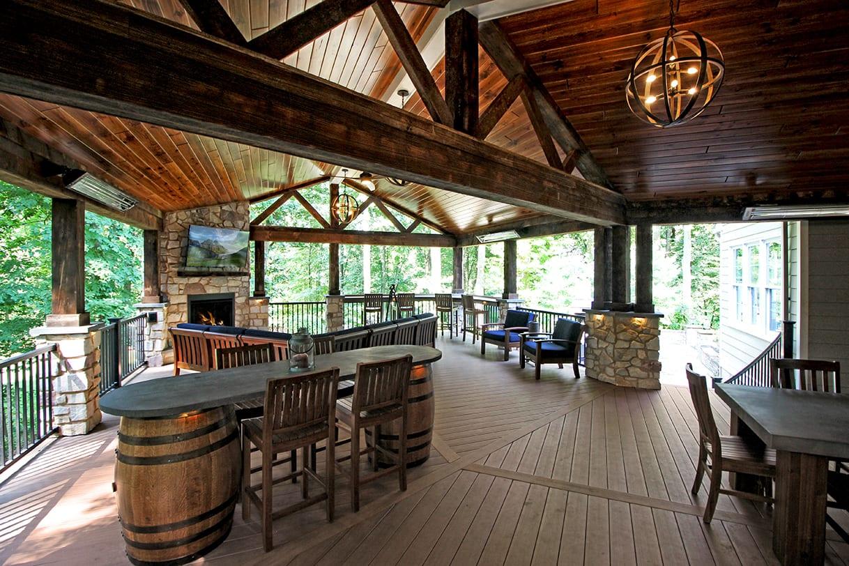 rustic deck design with jack daniels whiskey barrels