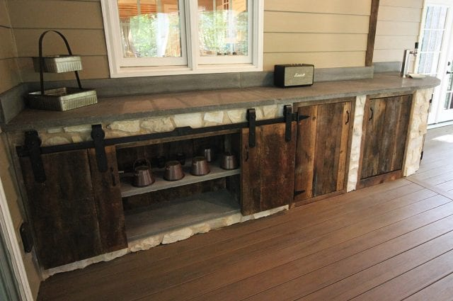 Mattice - TimberTech Porch with sliding cabinet