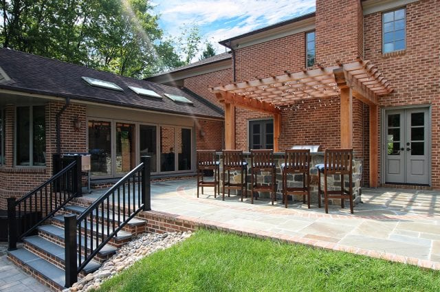 McElhaugh - flagstone patio and stairs with brick and fir pergola