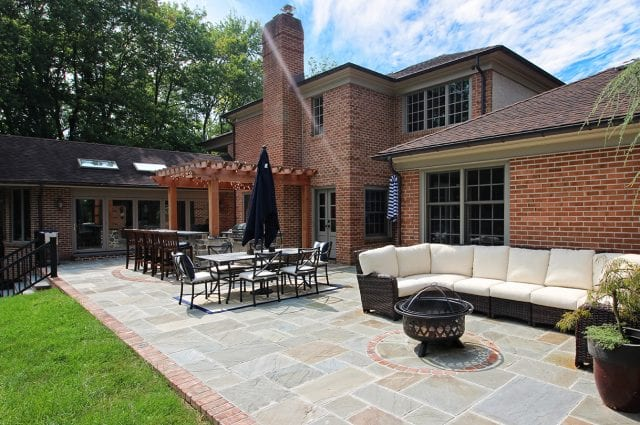 McElhaugh - flagstone patio with brick and firepit area