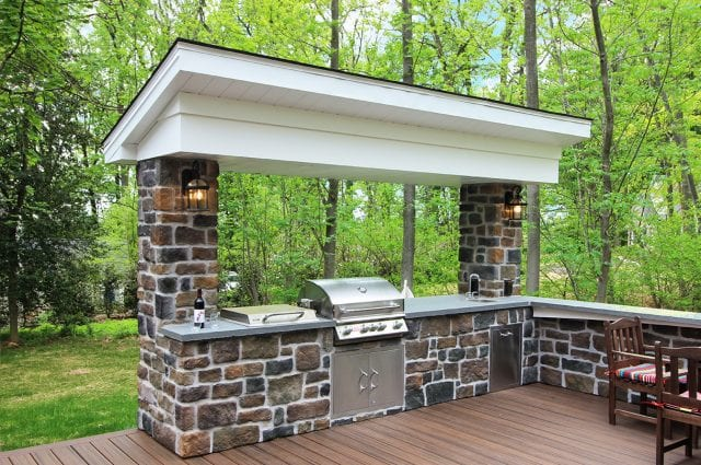 Arjan Timbertech Deck and porch with stonework Kitchen