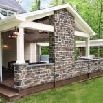 Arjan Timbertech Deck and porch with stonework and lighting