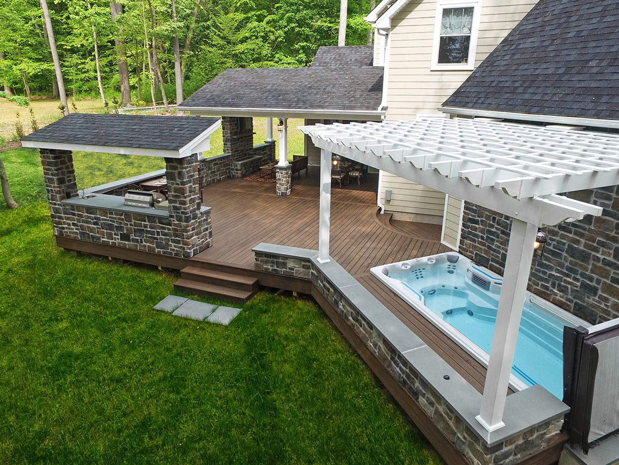 deck with in-ground hot tub