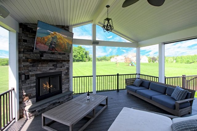 Barba - TimberTech deck and screened porch fireplace