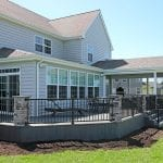 Barba - amazon mist TimberTech deck and porch with stonework