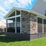 Barba - amazon mist TimberTech deck and screened porch with stonework
