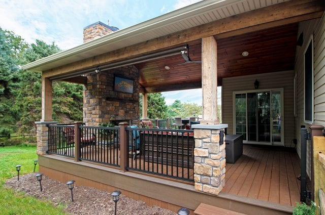 Beck - TimberTech deck and porch with fireplace and TV