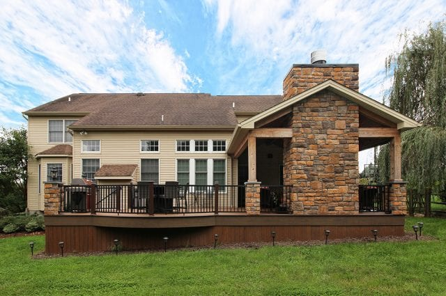 Beck - TimberTech deck and porch with stonework and barnwood