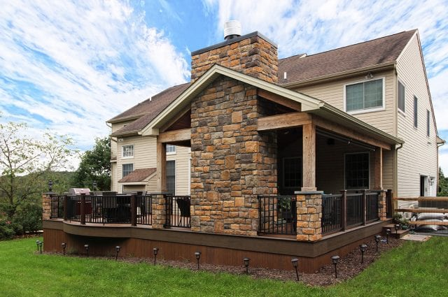 Beck - TimberTech deck and porch with stonework fireplace