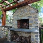 Broderick - Trex deck with stone wood-burning fireplace