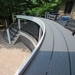 Brook - Pebble gray Trex deck with curved bar bumpout