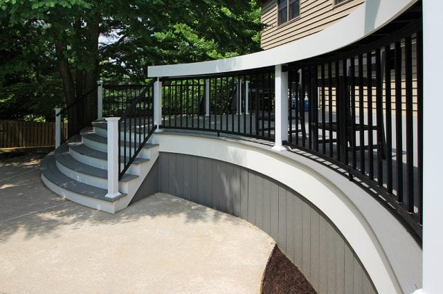 Brook - Pebble gray Trex deck with curved steps and bar bumpout