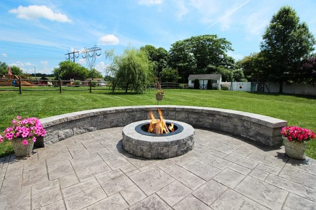 Canuso - Patio with sitting wall and fire pit