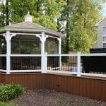 Cheung - timbertech deck with vertical decking and screened gazebo