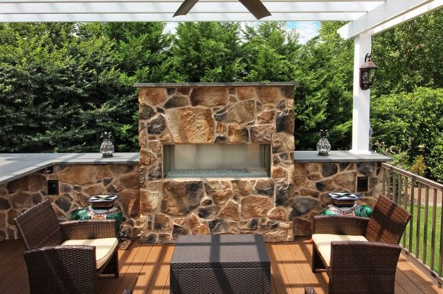 Drum - TimberTech Deck and pergola with stonework fire featue
