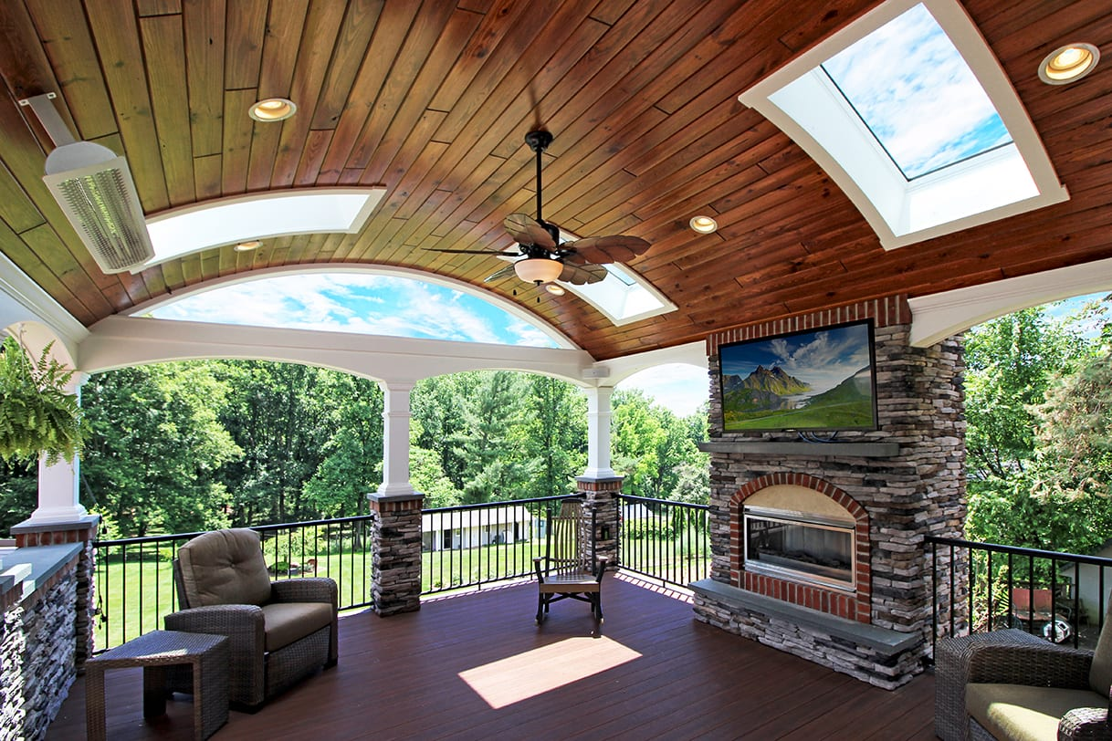 covered back porch with barreled ceiling