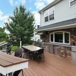 Chonko Trex deck with stonework kitchen curved bar bumpout north whale pa