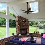 Geib - Brown Oak timbertech deck and porch with fireplace