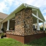 Geib - Brown Oak timbertech deck and porch with stonework