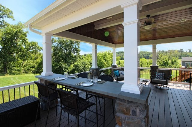 Soutner - Mocha TimberTech deck and porch with stone bar counter