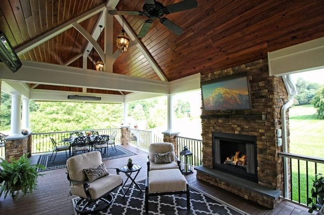 timbertech luxury porch with fireplace and furniture