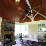 timbertech porch with tv fireplace