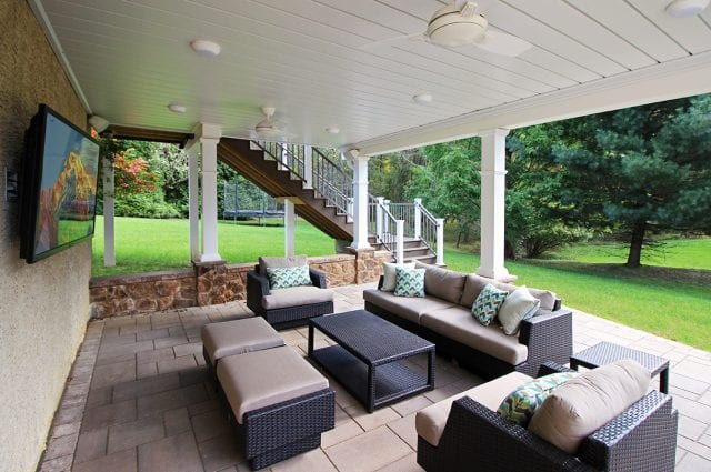 Casey - Flagstone patio with stonework and under deck oasis with TV